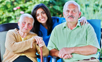 senior couple with their caregiver