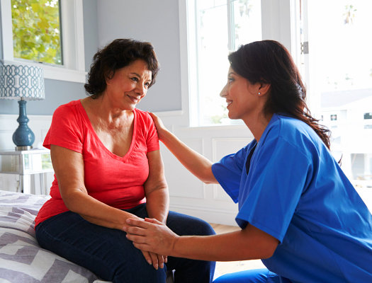 senior woman talking to her caregiver
