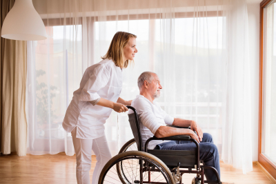 nurse and senior man in wheelchair