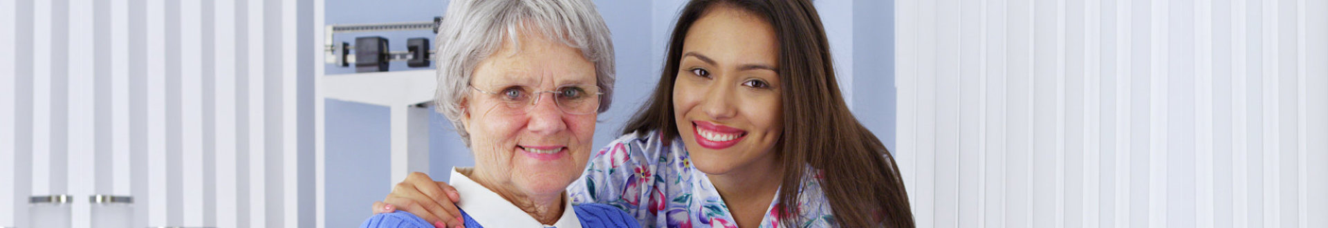 smiling senior woman and caregiver